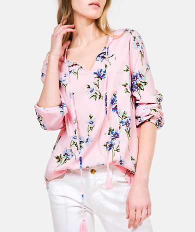 Floral print blouse with round neckline, tasseled ties fastenings, long sleeve and gathered cuffs