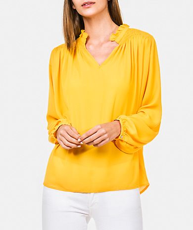 Gathered blouse with smocked detail, gathered collar, v-neck, loose cut and long-sleeve