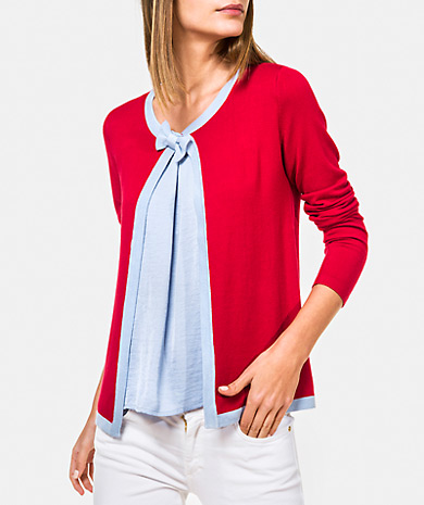 Knit caridgan with a contrasting bow, round neckline, long-sleeve and snap fastening
