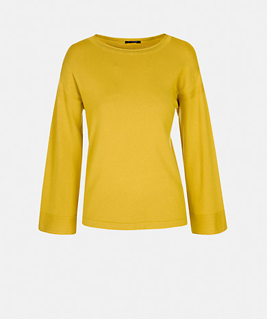 Round neckline knit sweater with dropped shoulder and long sleeve with details
