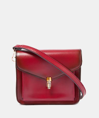 Shoulder bag removable strap snap closure inside pocket and zip fastening