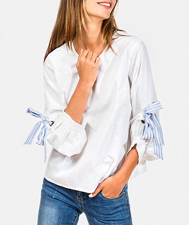 Round neckline blouse made from 100% cotton with 3/3 sleeve and keyhole with button at the back.
